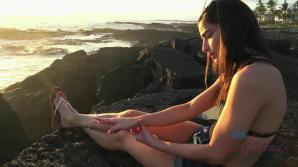 Emily enjoys the shoreline, and a sunset.